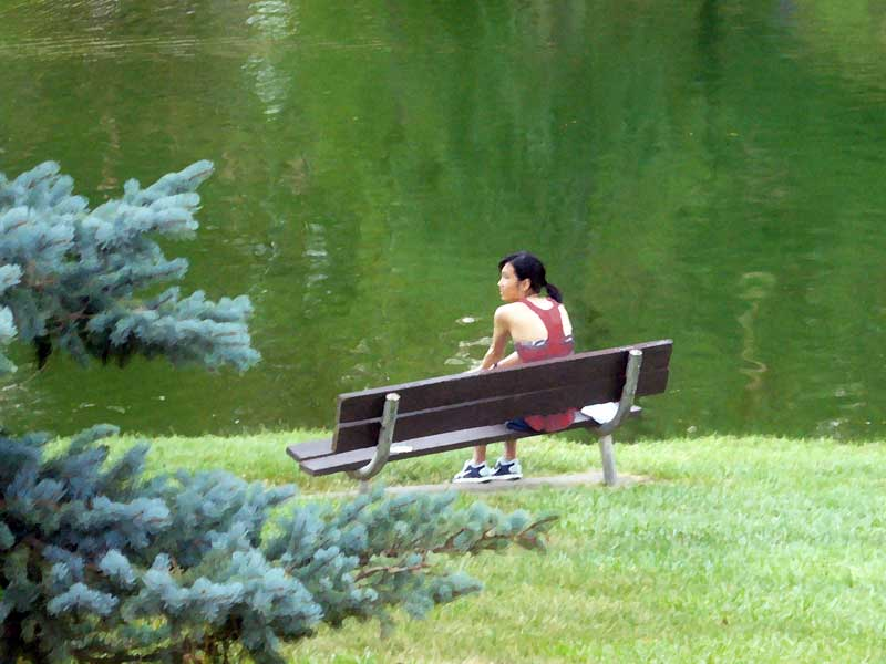 MooScience: Girl takes a rest on a park bench.